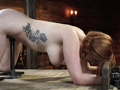 Redhead slavegirl is machine fucked and flogged while being tied up
