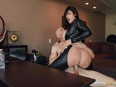 Huge tits slut in a shiny black catsuit sits on a big dick