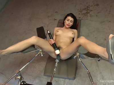 Raven Rocket feeds her unshaved cunt with sex toys and her fingers