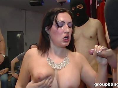 Mature glamour slut on her knees getting fucked during a gangbang